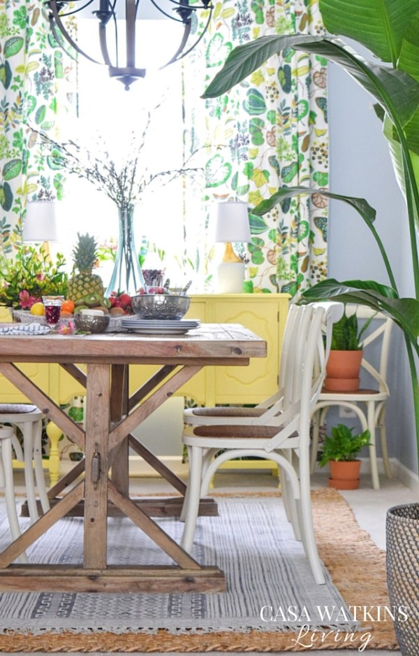 Love all the colors in this Global, Tropical style dining room