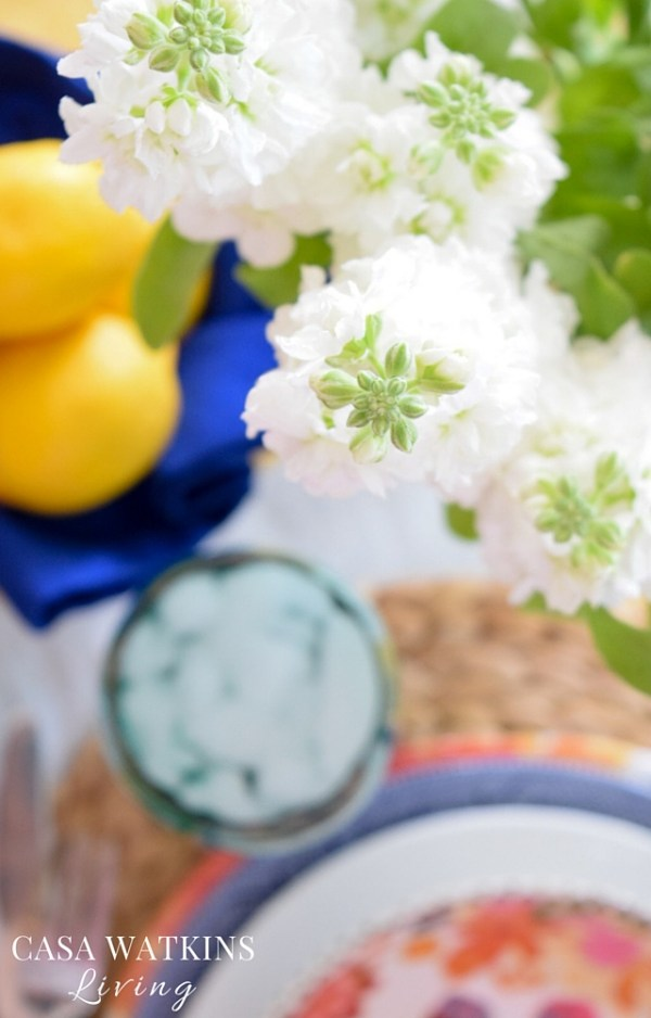 Mix white florals with bold plate colors for beautiful spring tablescape