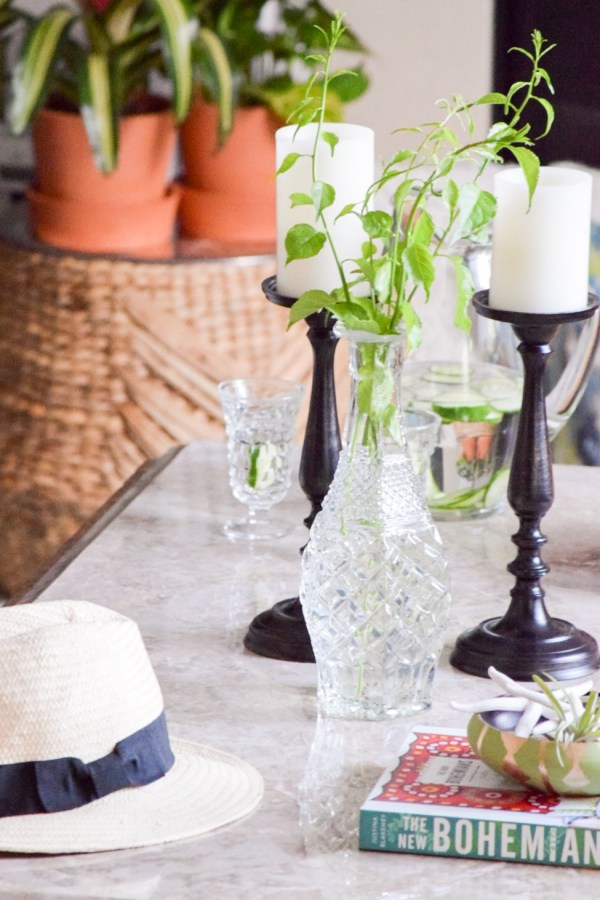 Use thrifted decanters and candlesticks for simple summer style
