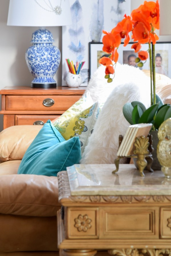 Pair colorful pillows with chinoiserie ginger jar lamp for color/pattern mixing