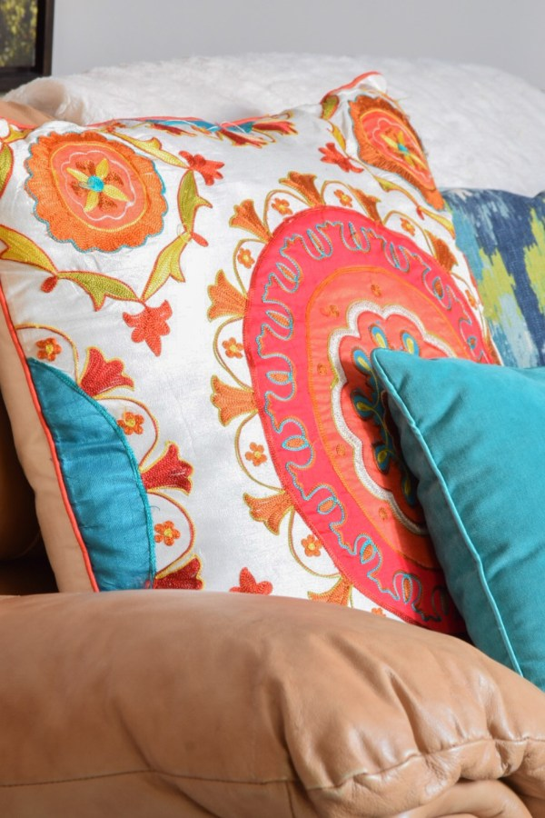 Use vibrant handmade pillows this summer