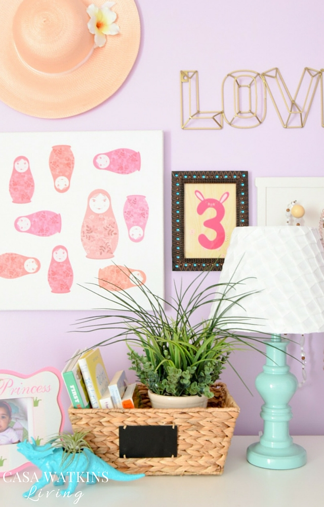 Use an assortment of items to build girl's room gallery wall. Sun hat, framed birthday cards, and custom canvas art.