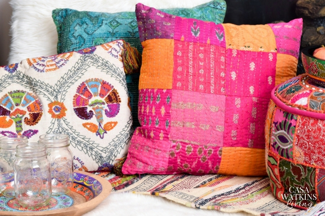 Mix pink patchwork pillows with embroidered pillows for boho global style