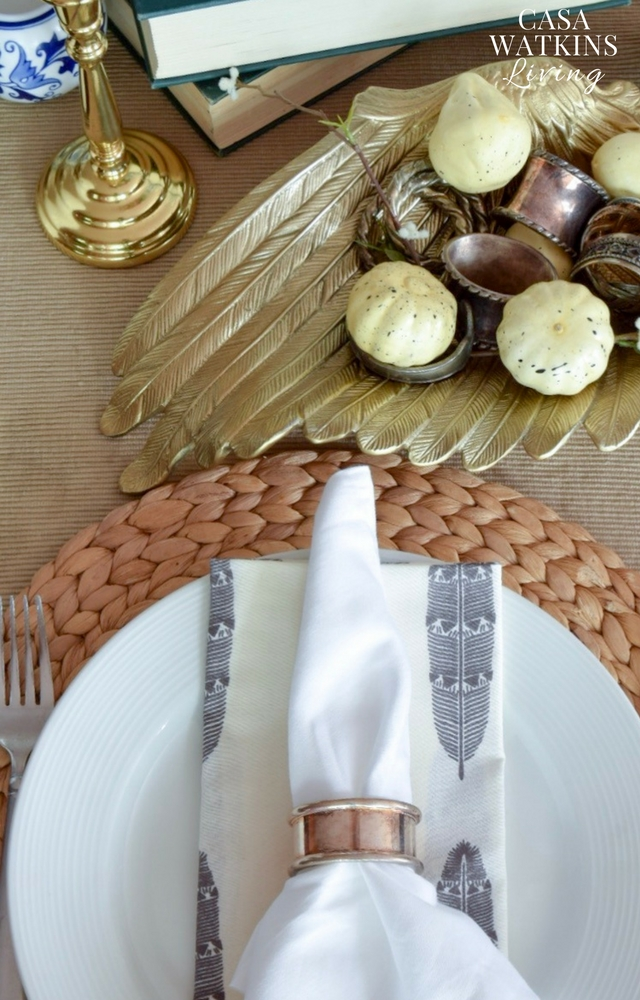 use mini pumpkins mixed with vintage napkin rings for centerpiece