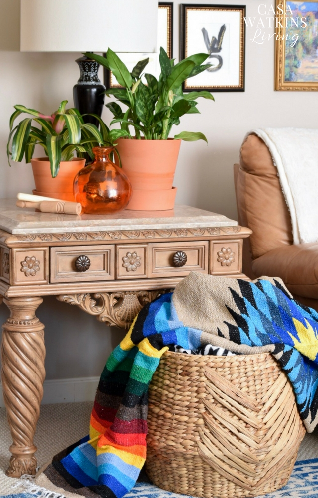 Instant color pop by decorating with Mexican blankets in a basket