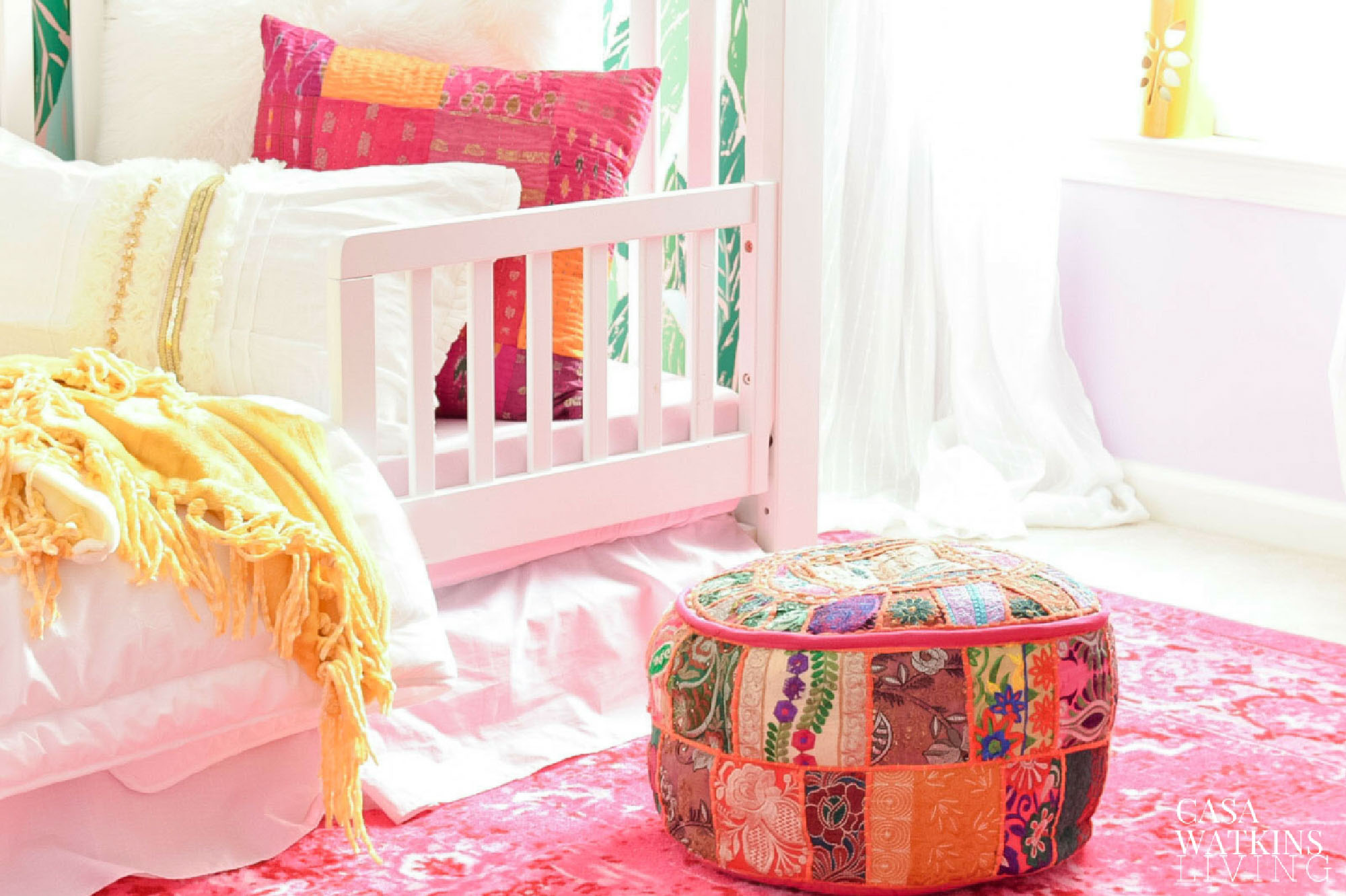 Moroccan style pouf in global boho girls room makeover