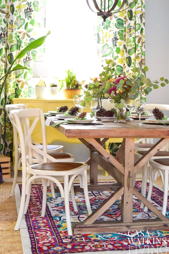 colorful dining room with bold persian rug and pinecones