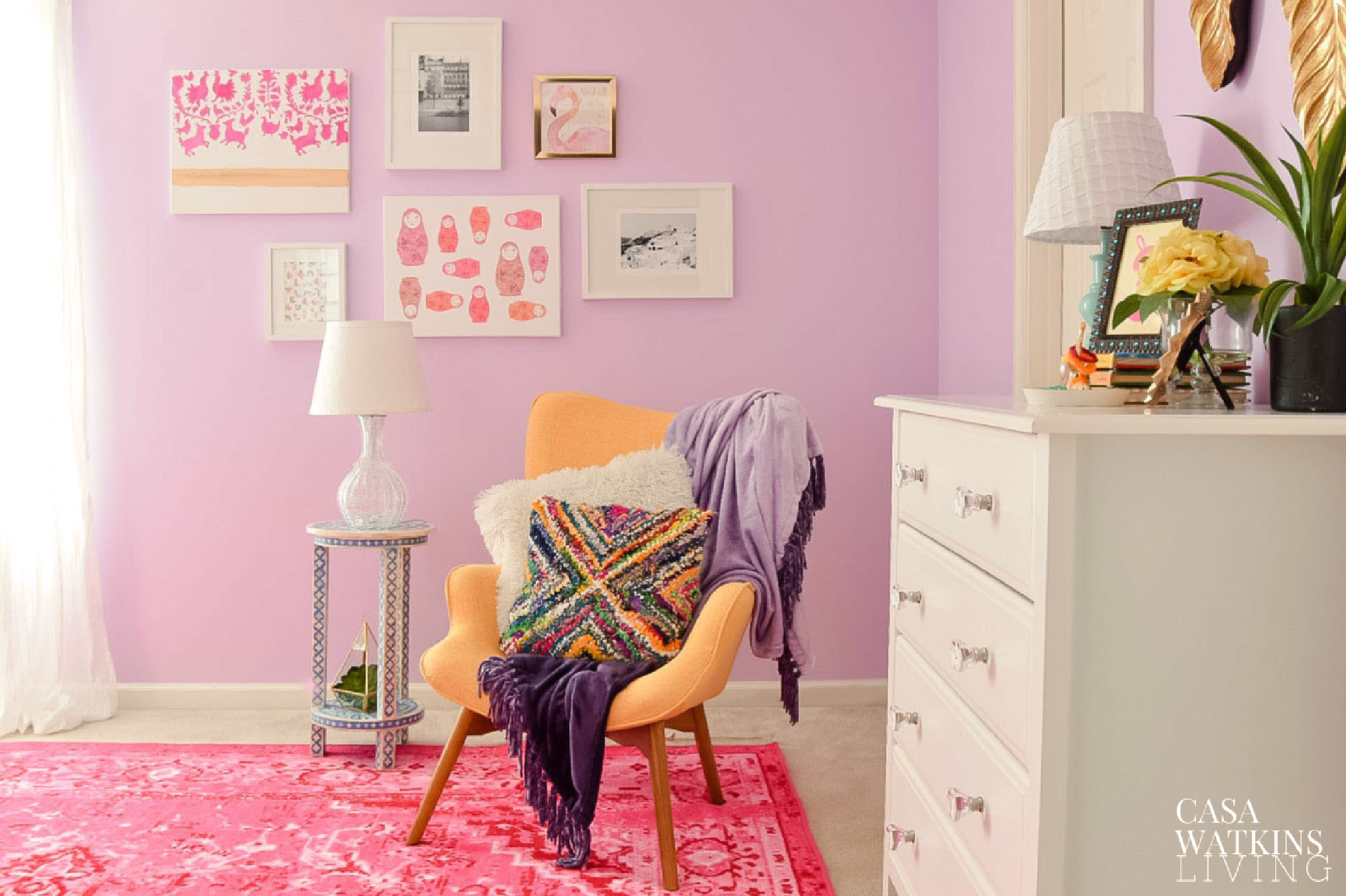 pink and purple boho girl's room with gallery wall