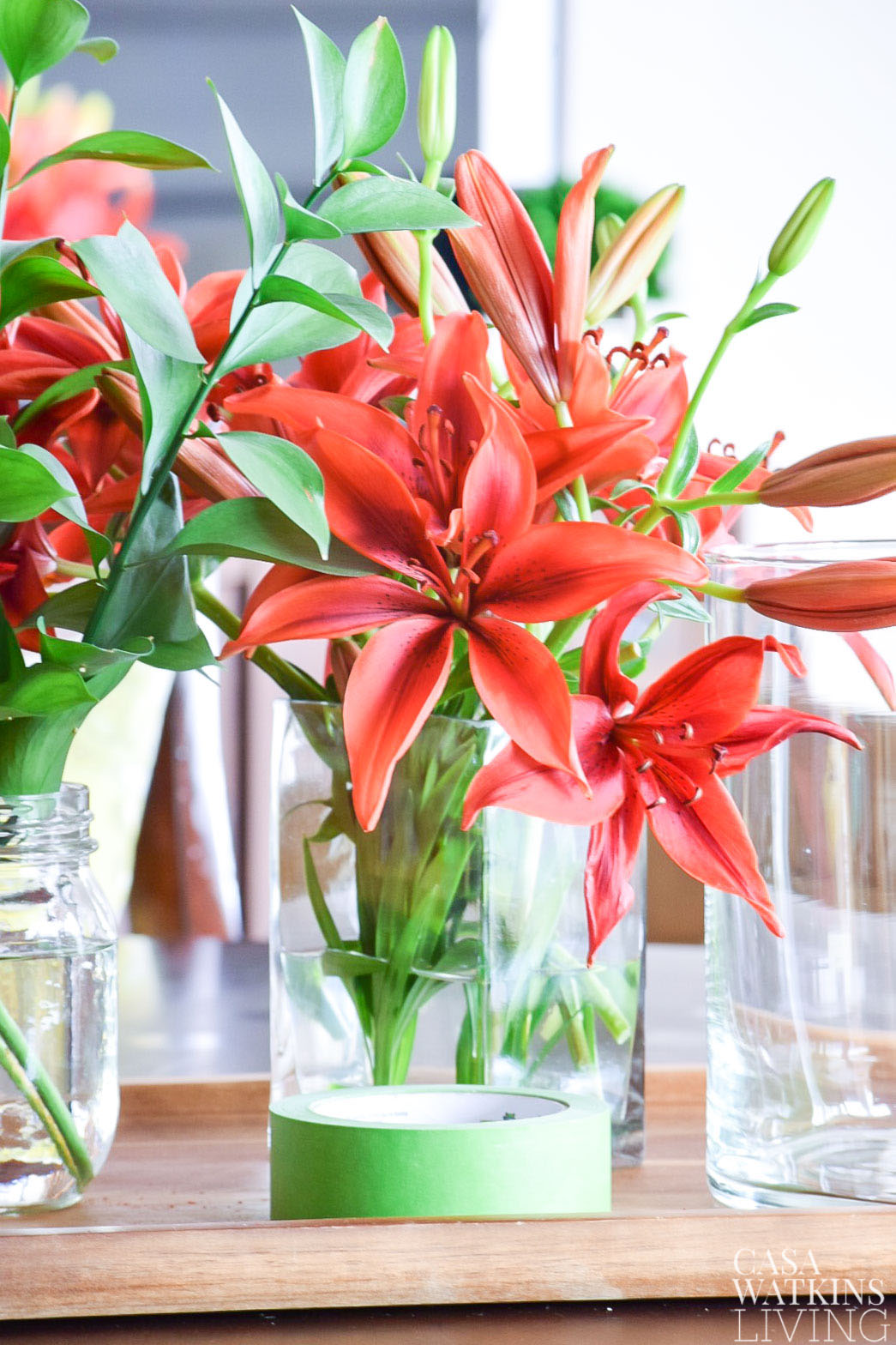 pretty spring arrangement of lilies in a glass vase