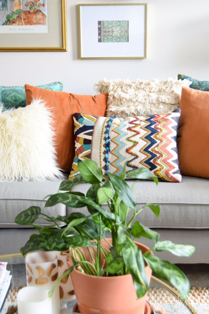fall colored pillows in global style home