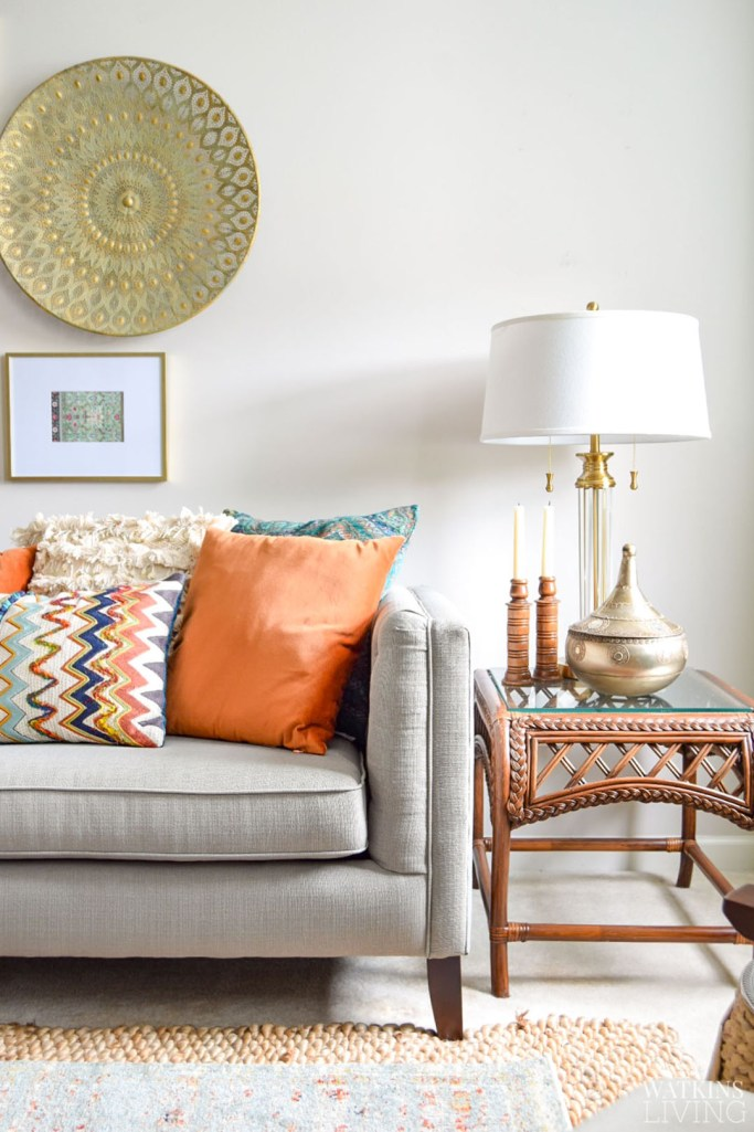 ornate round wall decor with boho style pillows