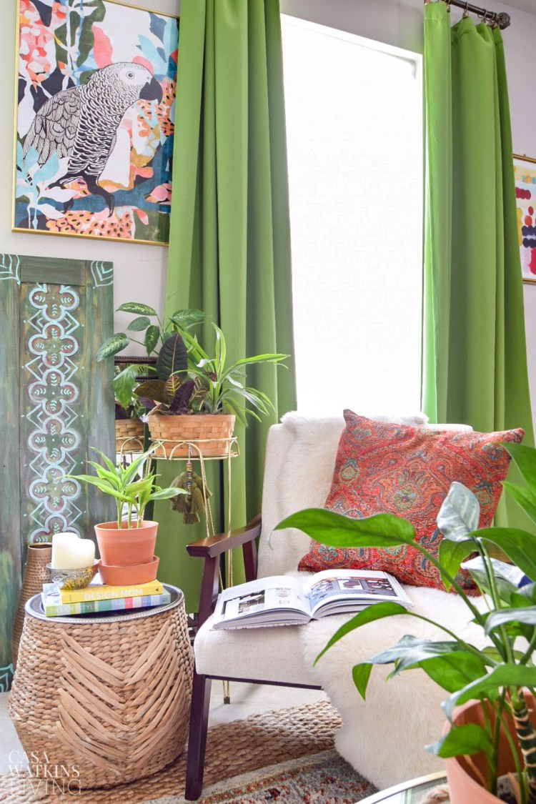 boho style reading nook with diy decorative tassel on plant stand