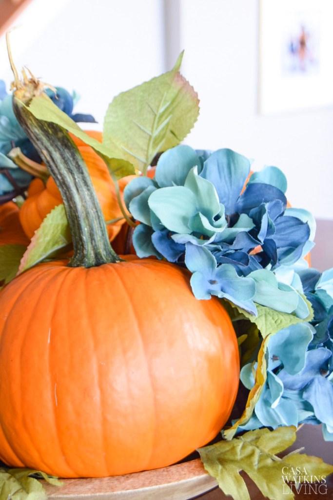 diy simple 5 minute pumpkin centerpiece with faux flowers