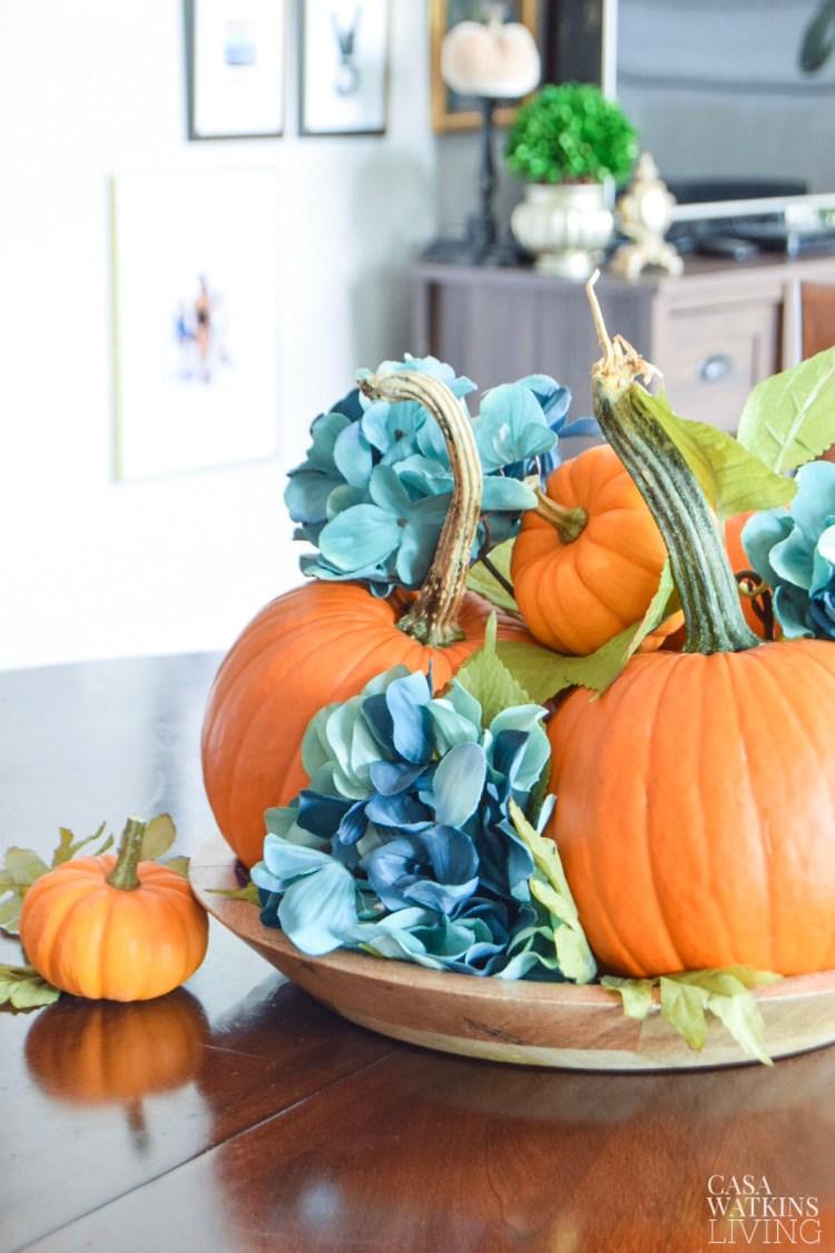 diy pumpkin centerpiece with faux hydrangeas