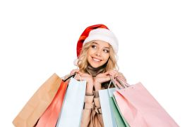 Low res cute girl with Santa cap and shopping bags