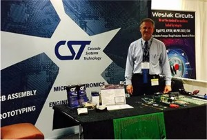 CST electronic contract manufacturing services rep at a trade show