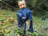 Scarecrows are usually to keep the birds out, but the .38 Special it's holding seems to be directed more at the hikers.