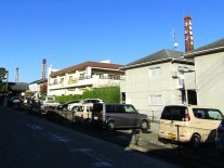 The chimneys of three of Saijo's sake breweries rise above the modern apartments. Only Saijotsuru still uses its chimney in production, but the preserved steam stacks are part of the attraction today.