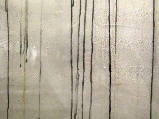 A white wall stained by the radioactive black rain that fell as the bomb remnants mixed with the residue from the fires.