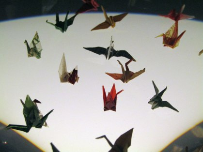 Actual cranes folded by Sadako Sasaki in her hospital room as she battled leukemia. These are about the size of a U.S. quarter.