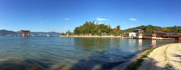 A panorama of Miyajima's World Heritage properties. Left to right: The Great Torii; Toyokuni Shrine and its five-storied pagoda; and Itsukushima Shrine