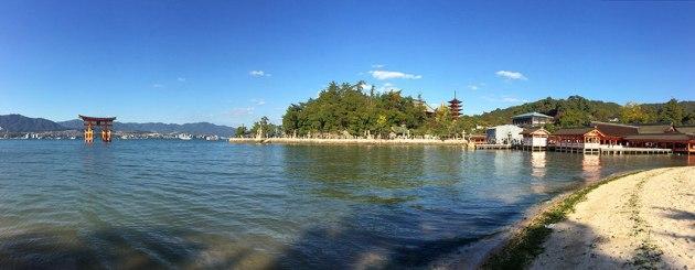 A panorama of Miyajima's World Heritage properties. Left to right: The Great Torii; Toyokuni Shrine and its five-storied pagoda; and Itsukushima Shrine