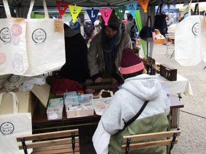 Decorating reusable bags featuring the Kawagoe Farmers Market logo