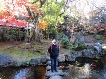 Standing in the tranquil Shinchi Teien garden on the outskirts of Yasukuni Shrine