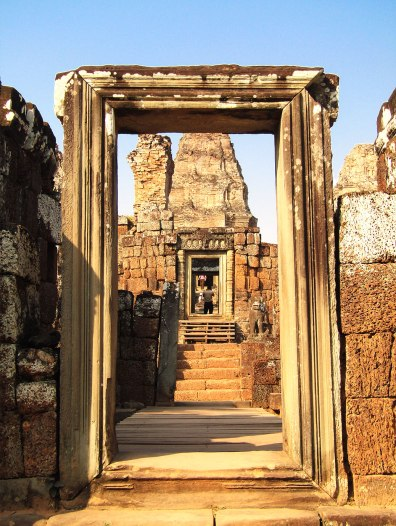 An ornate doorway stands in the ruins of East Mebon temple, offering a perfect frame for visiting photographers.