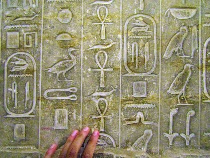 """The symbol that I'm touching is the ankh, also known as key of life. This series of symbols means """"He lives, he lives, he lives."""""""
