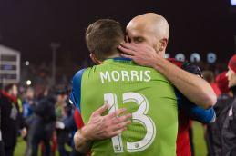 Jordan Morris gets a hug from Michael Bradley