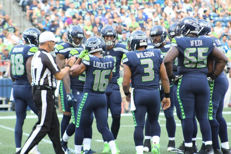 Seahawks offensive huddle