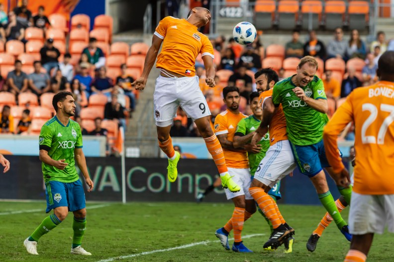 Marshall heads the ball towards the back of the net