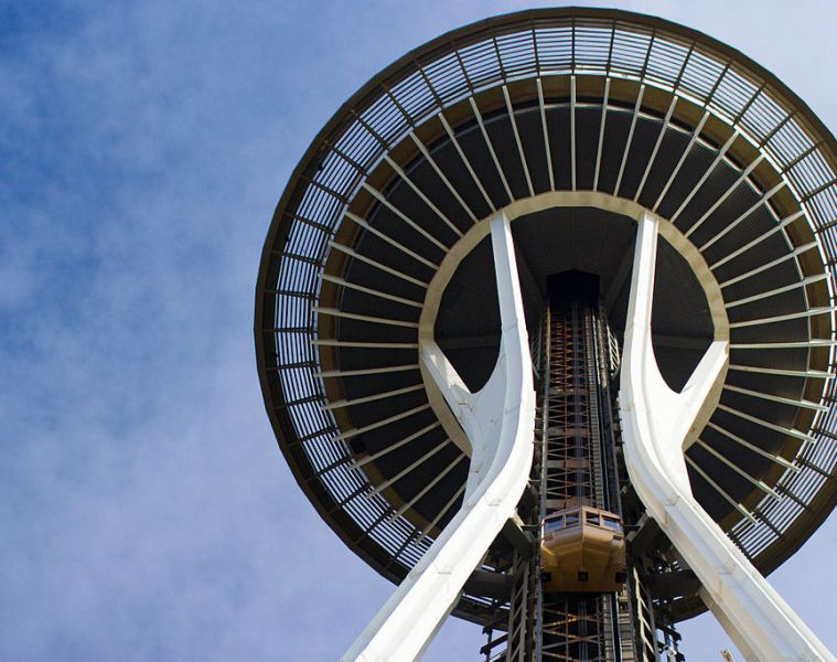 A photo of Seattle's Space Needle from underneath against a blue sky