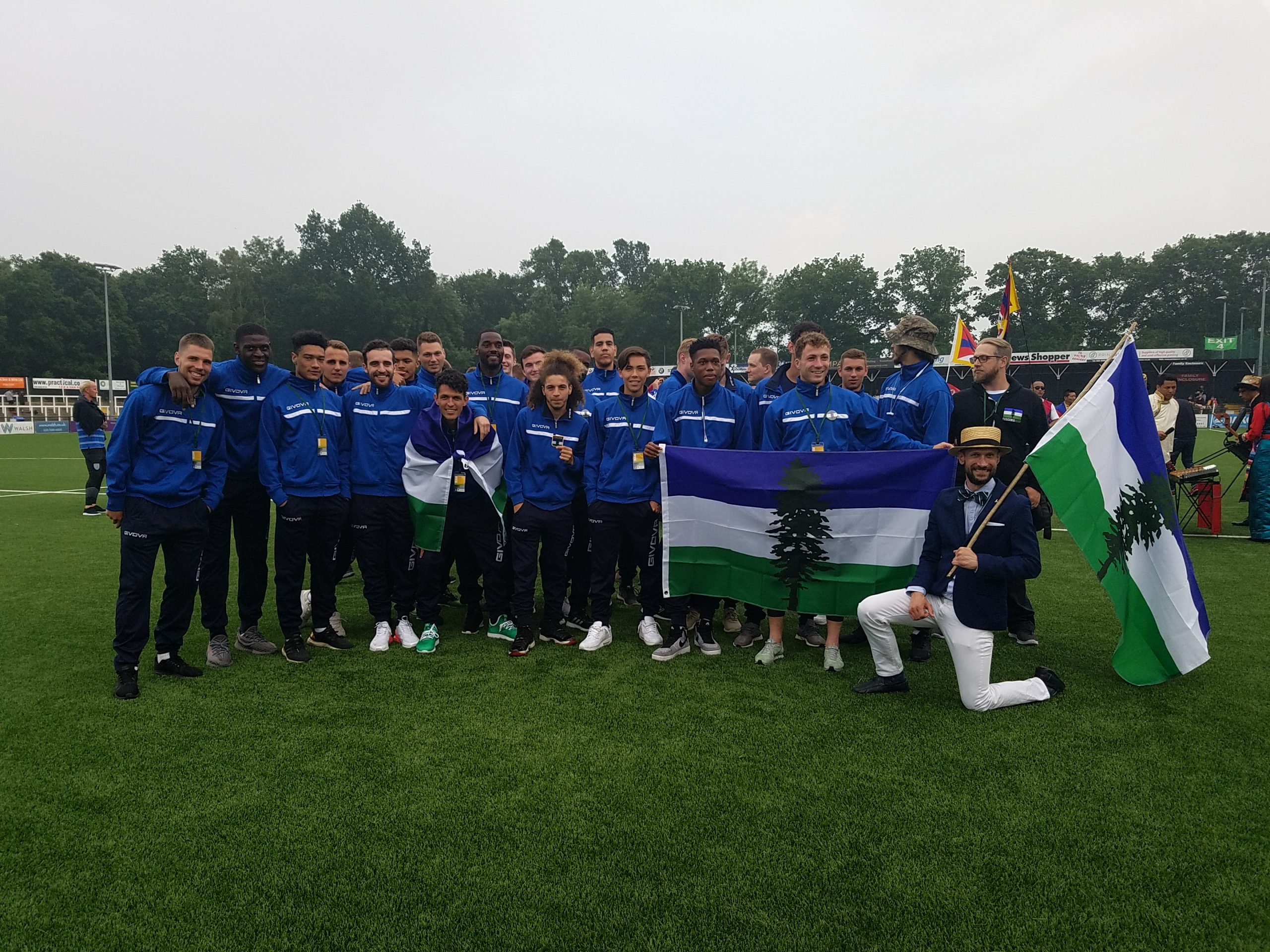 Team Cascadia huddled together after marching in the opening ceremonies of the CONIFA World Football Cup 2018