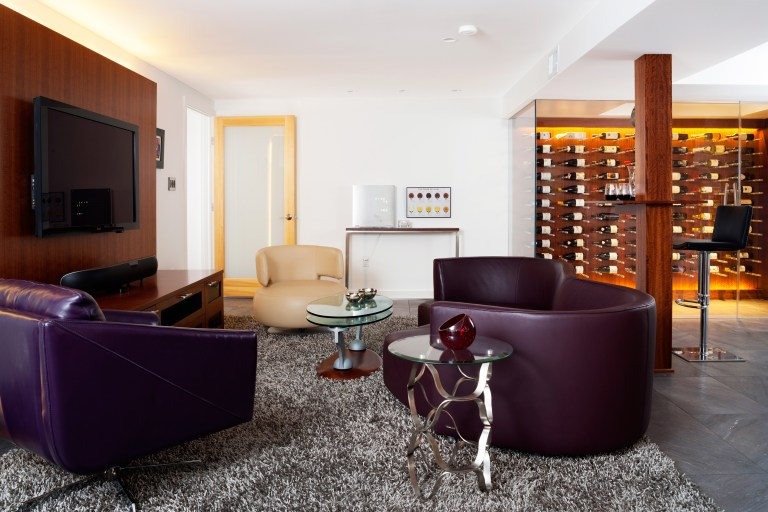 modern renovated basement white walls with dark accents natural wood glass leather