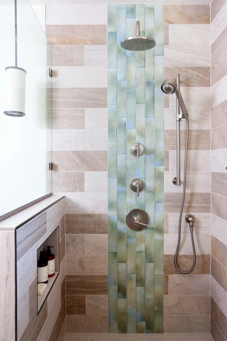 rain waterfall shower head natural color palette modern bathroom tile contrast storage nook