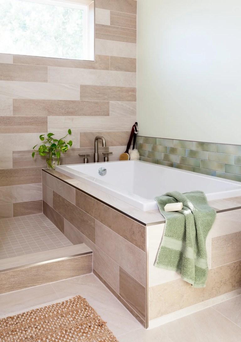 modern bathroom separate tub natural color palette tan sage green tile