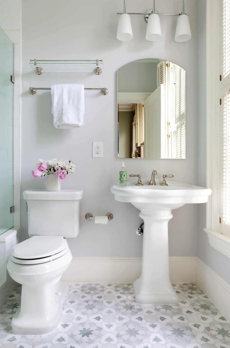 neutral color palette bathroom geometric mosaic tile floor design sconce lighting