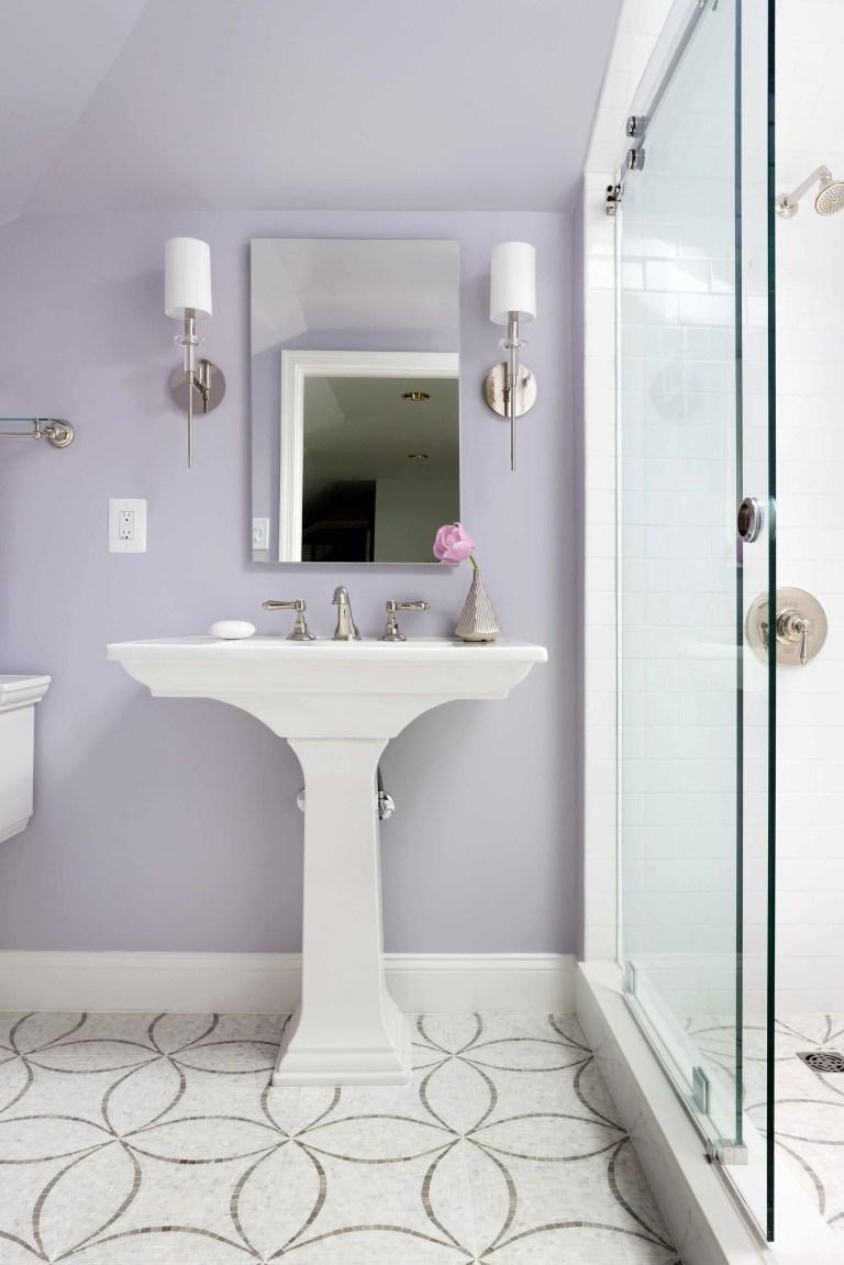 bathroom with light purple walls tile floor design shower with glass door sconce lighting