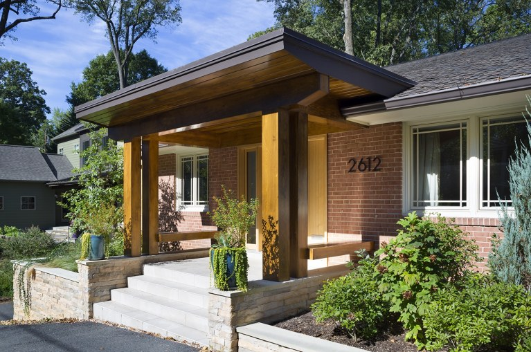 updated modern brick home front porch curb appeal wood columns stone foundation mixed materials