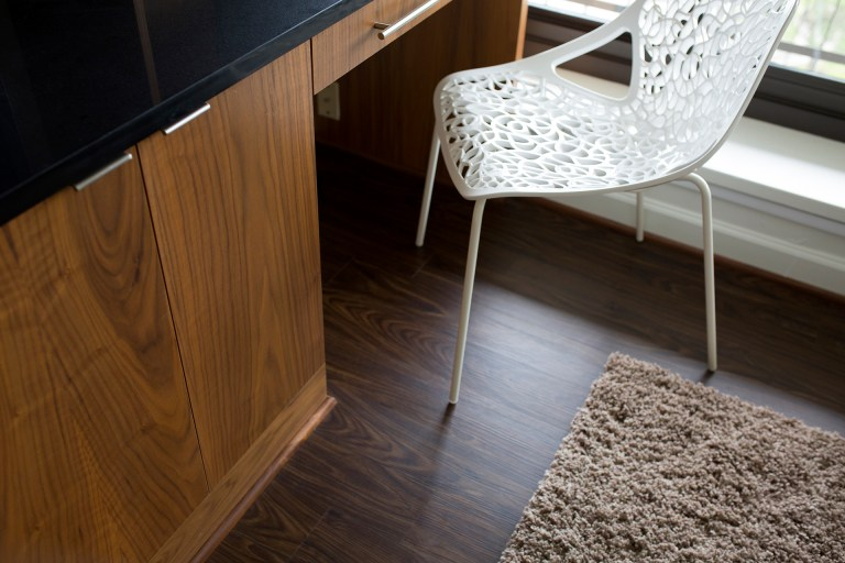 close up of built in desk area and wood floor dual wood tones