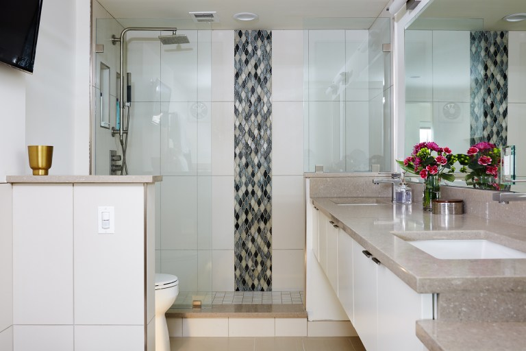 master bathroom floating vanity with double sinks separate shower with glass wall and mosaic tile stripe detail