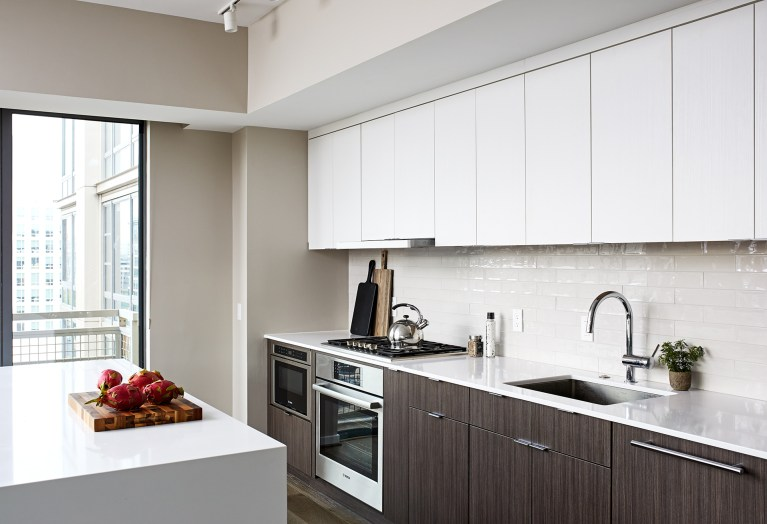 best kitchen remodeling dc with white brick backsplash and white granite countertops