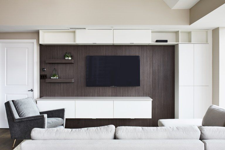 Best dc remodeler living room with mounted tv on a half brown wall with hanging cabinets on top