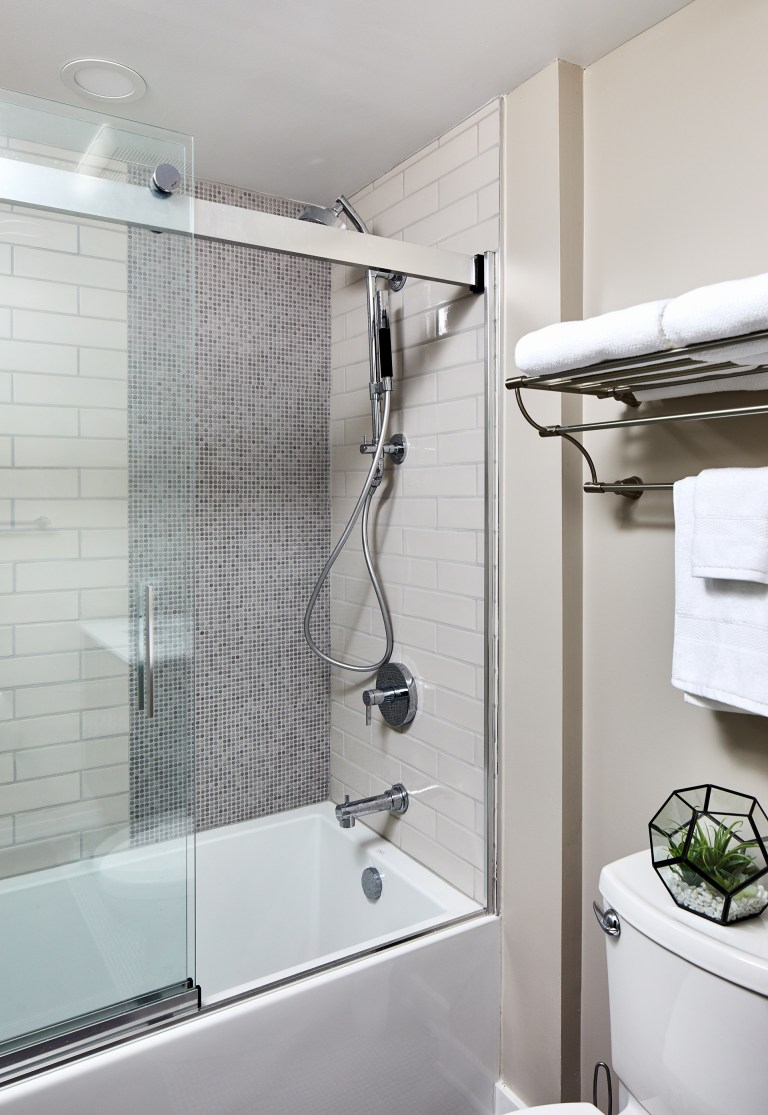dc remodeler bathroom with clear semi framed sliding glass door with chrome shower head
