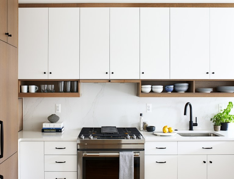 dc remodeling with white cabinets with black knobs and hanging shelves