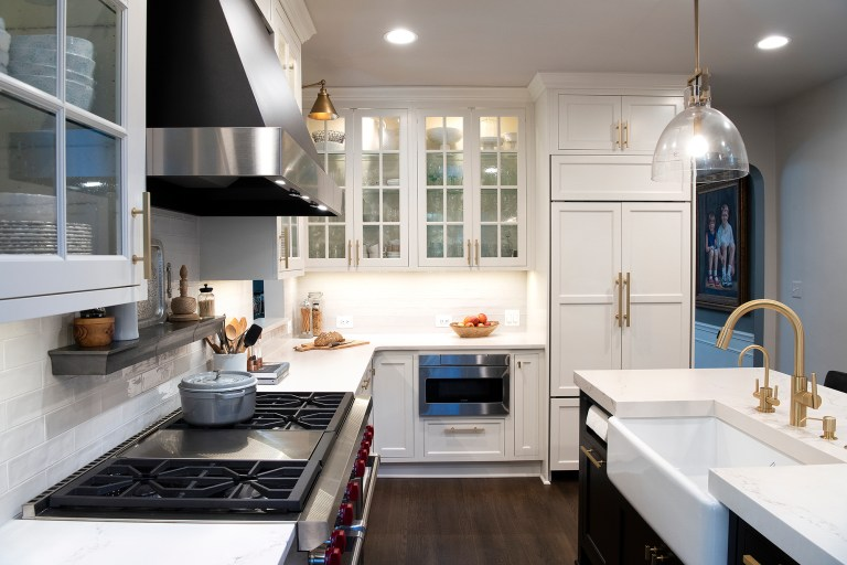 kitchen remodeling with stainless steel range top with 6 burners and griddle, farmhouse white sink, white cabinets with pull handles