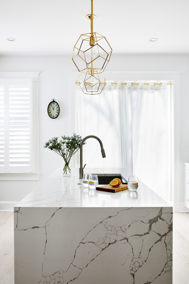 gold pendant lighting over a kitchen island