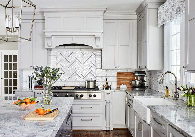 traditional design kitchen with white hood range